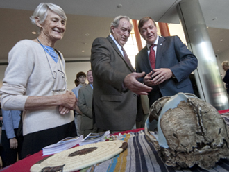 Stony Brook University President Samuel L. Stanley Jr., MD, (right) with Professors Richard and Meave Leakey, discussing fossils recovered at the Turkana Basin Institute.