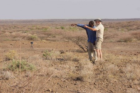 Excellent geologist Professor Frank Brown, from University of Utah pictured here with Cyprian Nyete from our team, looking out over the fossil exposures and possibly discussing the location of tuffs and sandstones.