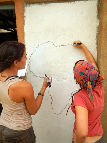 Luisa and Kat outlining the continent of Africa