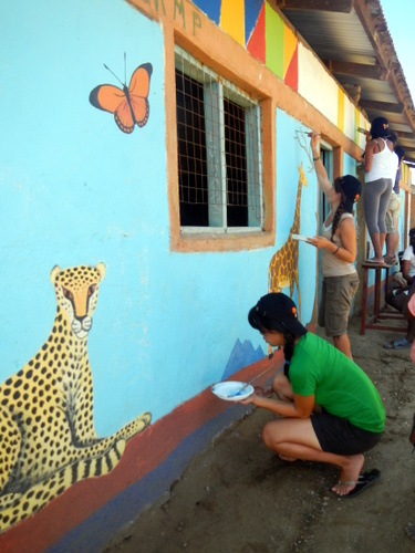 Students doing the final touches to the mural