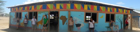 A panoramic view with some of the students next to the sections they painted