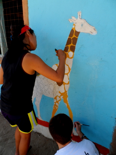 Lorraine and Zach painting the Giraffe