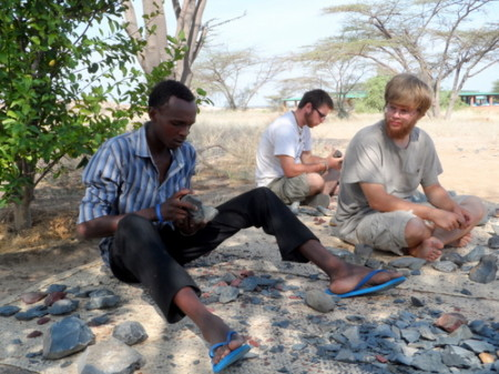 The men of the field school knap their stone tools, like their forebears did