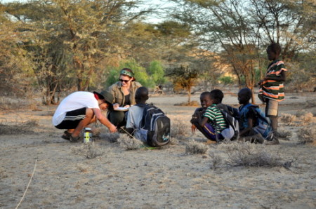 Rob and Kate are watched by a group of curious Turkana children on their way home from school