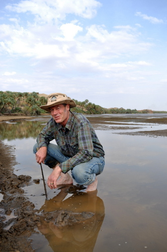 Dr. Raynolds looking at the stratigraphy of a sandbar in the Turkwel River.