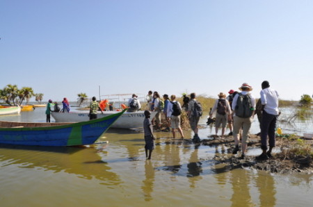 Students clamber into the boat at Kalokol fishil village.