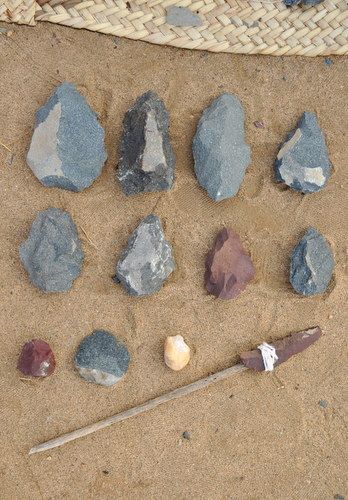 "Some of the tools produced by the students. The top two rows are Acheulean handaxes, and on the last row we have a rhyolite chopping tool, a phonolite retouched flake, a quartz chopping tool, and a retouched rhyolite ""flake-blade""."