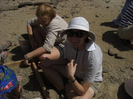 Katie and Abby continue the search for tiny bone fragments.