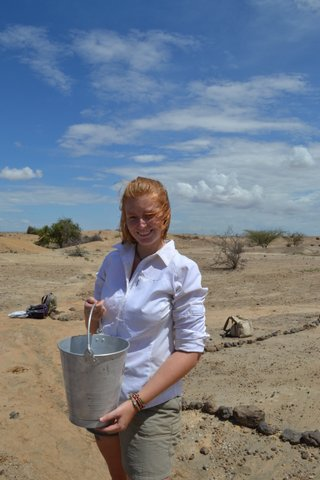 Katie has sieved through her first bucket of sediment and is ready to do it all again.