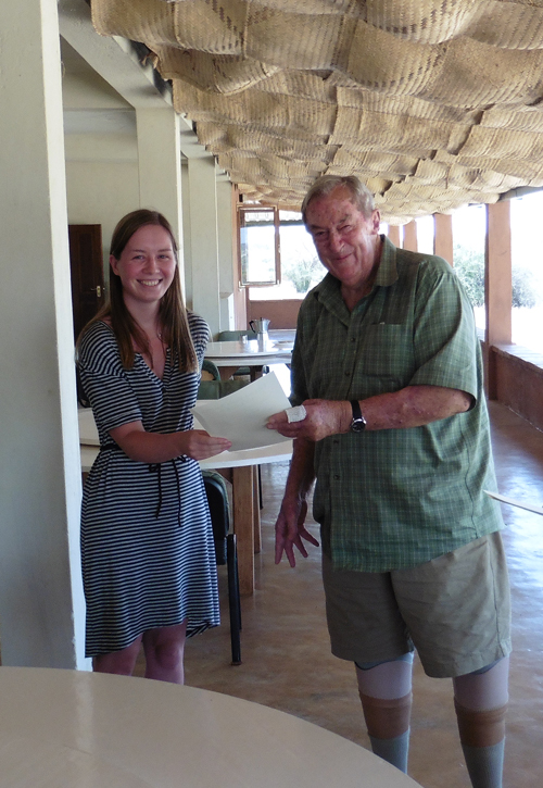 Eloise receives her certificate from Dr Leakey