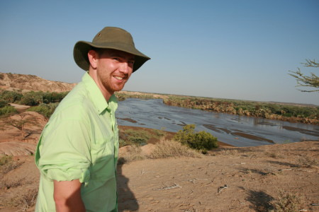 New Origins Field School Director, Dr. Jason E. Lewis, looking out over the fossiliferous exposures along the Turkwel river.