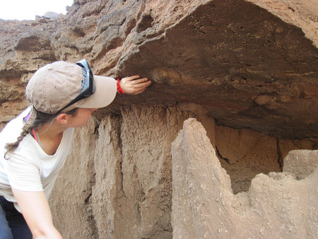 Anna examines the footprints that originally occurred in the lower mudstone and had been filled in by the sandstone.