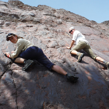 Rock climbers, Anna and Rachel, scale the footwall of the Lothagam fault.