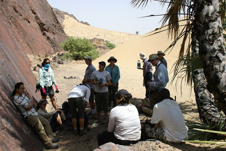 The group takes a water break along the Lothagam fault.