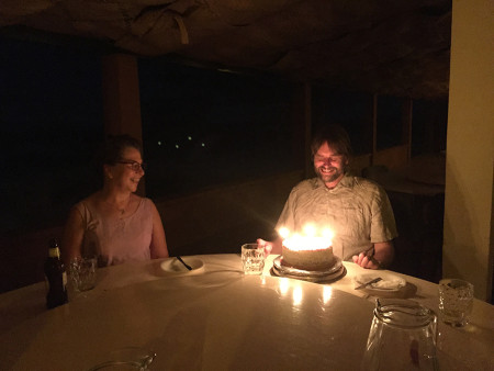 Dr. Mikael Fortelius' and his wife Asta admire his birthday cake.