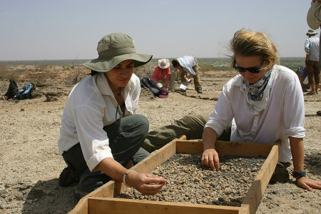 Jayde and Rachel look for fossils within rock fragments.