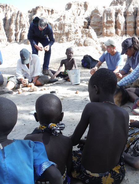 Local Turkana children show everyone how it's done by easily opening 3 - 5 nuts before TBI students would complete one.