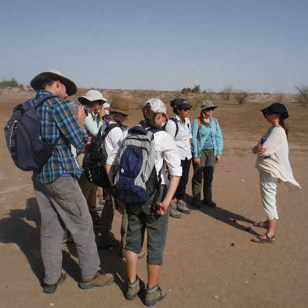 Dr. Harmand introduces students to flagging sites and carefully watching where they step.
