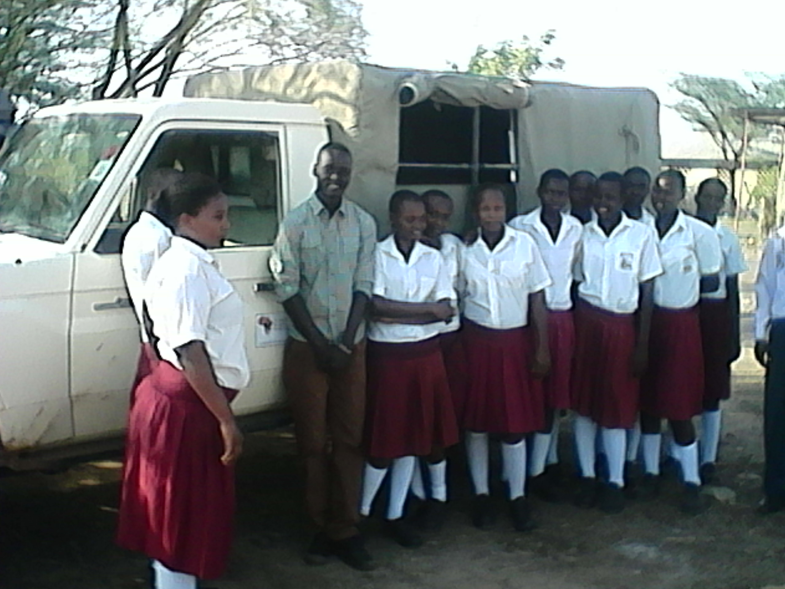 Students of Our Ladies Girls Secondary school, Kakuma (Turkana District) stand with me on my recent visit. They received bursaries from the Turkana Basin Institute at the beginning of the year in 2015.