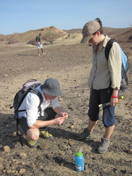 Dr. Skinner examines a fossil fragment that Anna had found.