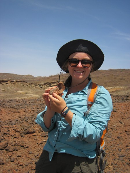 Page poses with her fossil find.