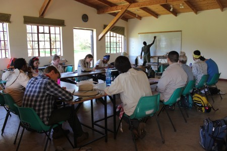 The students learn about methodologies for studying vegetation ecology from Mr. Kimani Ndung'u in the classroom at Mpala Research Center (Photo by Martha N. Mutiso).