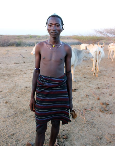A head of the boma shows us where he keeps his livestock.