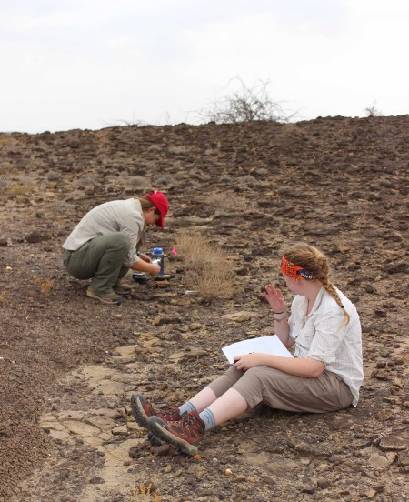Jen and Maddie practice their fossil finding and recording skills.
