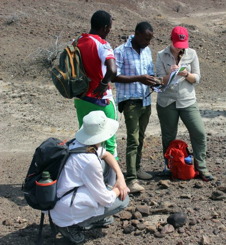Martin instructs Jen and Milena how to systematically record a fossil find.