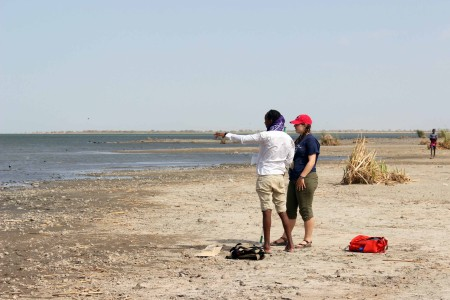 Yemane and Jen strategize which trajectory to perform their shoreline elevation transect.