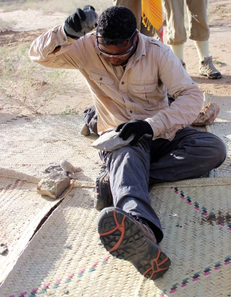 Tadele works hard at breaking apart this tough phonolite cobble - this material is no joke!