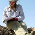 Jen carefully records information for the map of the Lothagam Harpoon site.