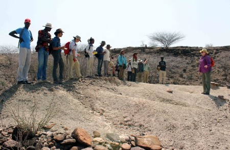 TA Hilary Duke gives the TBI students a tour of the Kokiselei sites, explaining the archaeological context in which the artifacts were found.