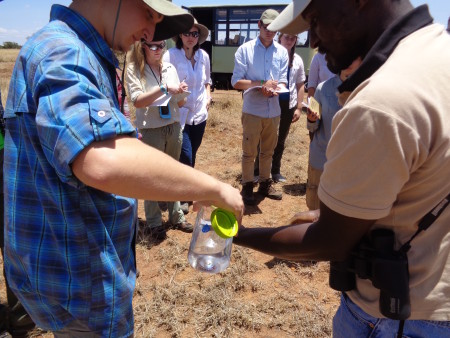 I assisted Kimani in this experiment by adding some of my water to the soil he collected