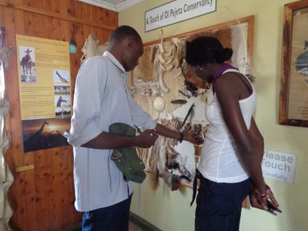 Toby and Esther reading about the different animals at the conservancy