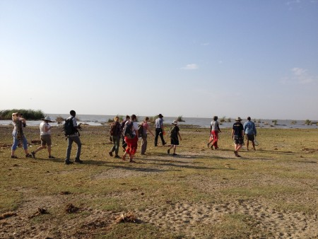 The students walk out to the lake near a fishing village to learn about lake ecology.