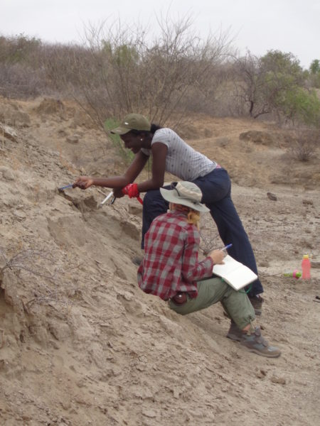 Esther and Emily clearing off a surface in order to get a better look at the sedimentology