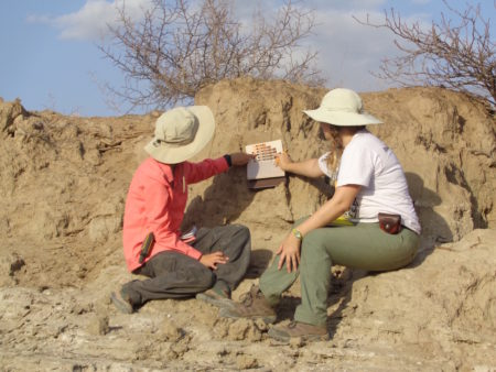 Kathryn and Carla use the Munsell chart to properly match sediment colors.