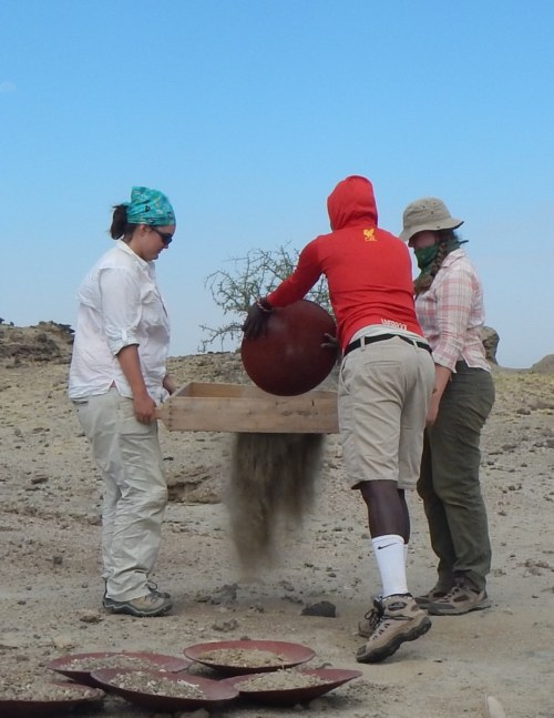 Morgan and Yvette give it a try too! Yvette is well prepared with her bandana because sieving can get really dusty in the desert!